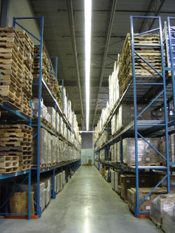 Aisle with pallets on storage racks